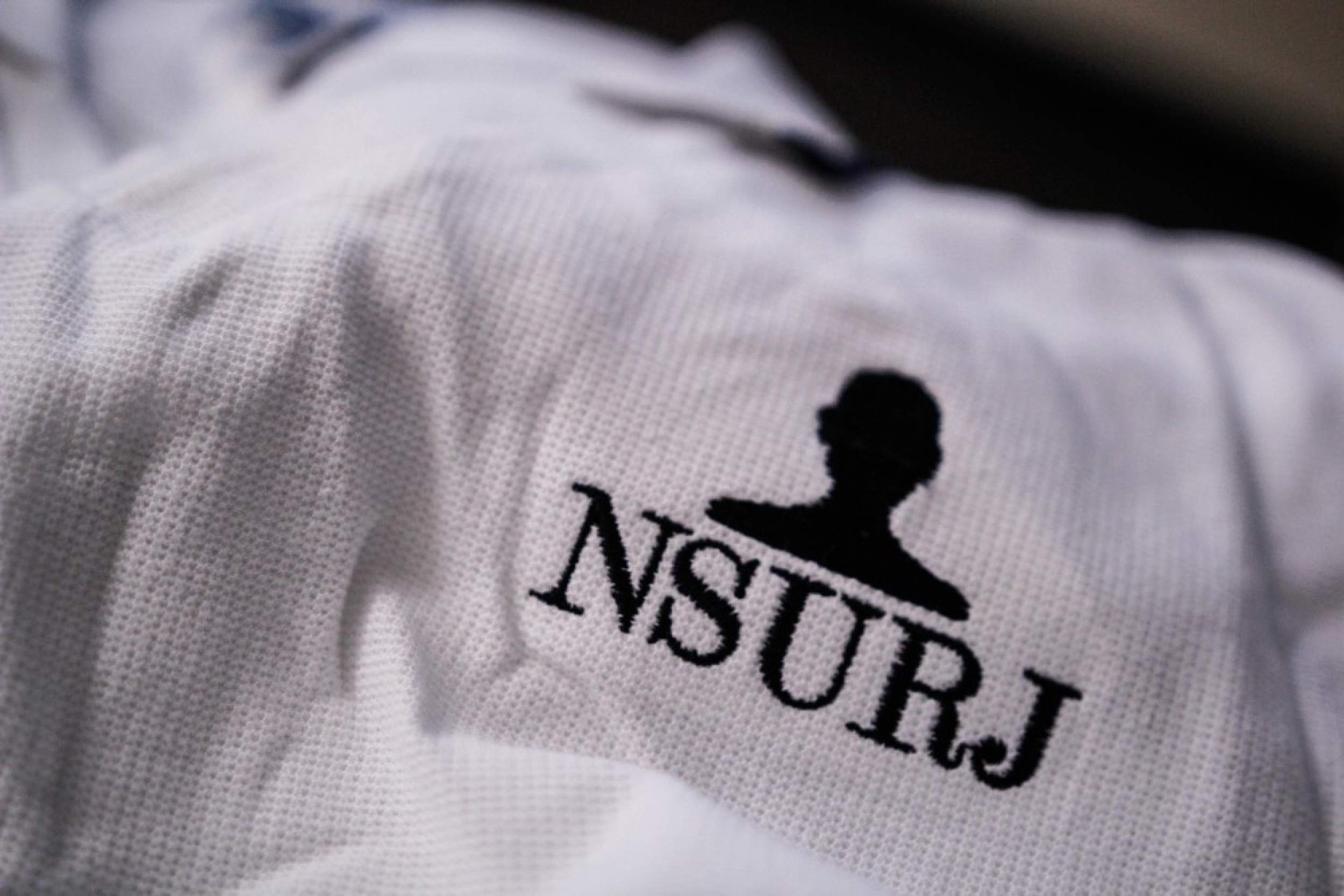 NSURJ Logo on a shirt